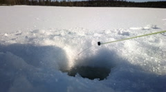 Ice fishing. As biting and caught small perch on forest lake Arkistovideo