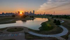 Dallas Skyline WS Time-lapse sunrise w/ lake and Trail w/ nice clouds Stock Footage