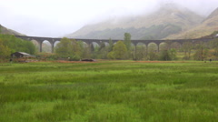 An amazing wide view of the Glenfinnian Viaduct in Scotland with steam train - stock footage