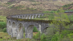 A steam train passes across the Glenfinnian Viaduct in Scotland. Stock Footage