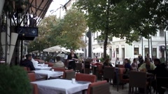 Busy restaurant terrace Stock Footage