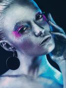 Aluminium girl with pink and purple eyeshadows makeup mua - stock photo