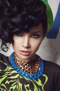 Beauty closeup portrait of brunette girl in green hat - stock photo