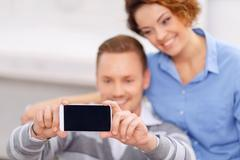 Pleasant couple sitting in the armchair Stock Photos