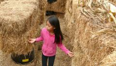 Two Girls Confused Inside Halloween Hay Stack Maze Stock Footage