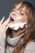 Young girl in sweater with foam beard - stock photo