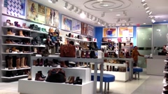 People looking shoes at shoe store - stock footage