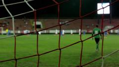 Part of the football game, soccer, tracking shot, focus on the goal net. Stock Footage