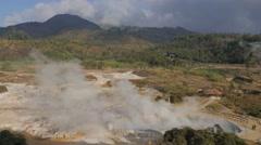 Steaming crater lake Kawah Sikidang in landscape,Dieng,Java,Indonesia Stock Footage