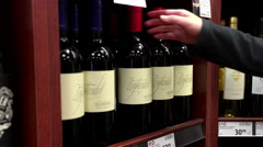 A hand takes bottles of Seghesio wine from the shelf with 4k resolution. Stock Footage