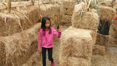 Little Girl Walking Through Halloween Hay Stack Maze Stock Footage