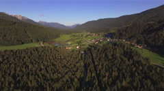 AERIAL: Urban mountain valley with houses and roads - stock footage