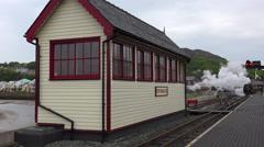 The Ffestiniog Railway steam train departs from the Porthmadog train station in - stock footage