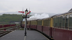 The Ffestiniog Railway steam train departs from the Porthmadog train station in Stock Footage