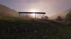 AERIAL: Flying over old hayrack in beautiful misty morning - stock footage