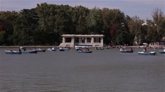 People in boats in buen retiro park madrid spain Stock Footage