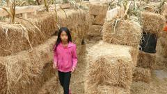 Cute Girl Navigates Halloween Hay Stack Maze Stock Footage