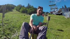 Stock Video Footage of SELFIE: Cheerful young man riding summer sledge rollercoaster