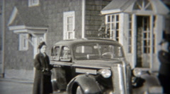 1937: Wealthy suburban women showing off their new cars. Stock Footage