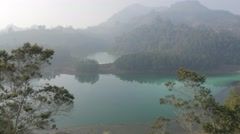 Turquoise hues in Telaga Warna Lake,Dieng,Java,Indonesia Stock Footage