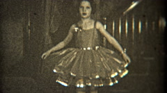 1936: Dancer practicing her craft indoors with fancy dress. Stock Footage