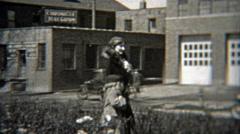 1937: People walking past old telegram building downtown. Stock Footage