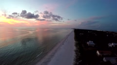 Gulf shore aerial- Sunset looking due West Stock Footage