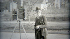 1936: Photographer setting up the shot directing people to move over. Stock Footage