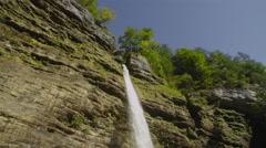 SLOW MOTION CLOSE UP: Big majestic waterfall splashing on rocks Stock Footage