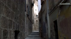 Ancient and narrow cobblestone street in Granada, Spain. Stock Footage