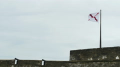 The Cross of Burgundy Flag Symbol of Spain 1506 to 1785 on Fort and Cannon Stock Footage
