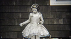 1936: Confident ballet girl solo dancing in front of house. Stock Footage