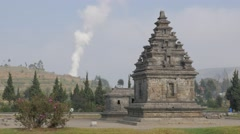 Arjuna ancient hindu temple complex with steam,Dieng,Java,Indonesia Stock Footage