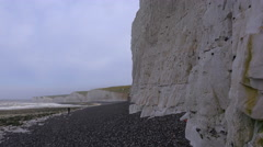 A distant woman walks along the White Cliffs of Dover near Beachy Head in Stock Footage