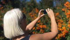 Mature Woman Taking Pictures with Smart Phone in Nature Stock Footage