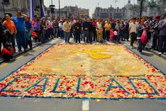 Colorful ground paintings at Lord of Miracles catholic religious procession - stock photo