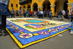Colorful ground paintings at Lord of Miracles catholic religious procession Stock Photos