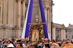 Lord of Miracles Idol at catholic religious procession during purple month in Stock Photos