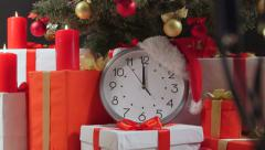 Christmas New Year countdown clock is ticking under Christmas tree Stock Footage