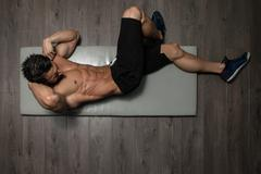 Healthy Man Doing Abdominal Excerise On Foor - stock photo
