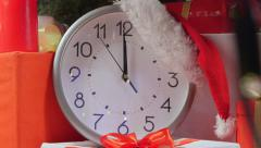 New Year clock ticking under Christmas tree - stock footage