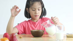 HD Footage, Dolly young Asian girl eating cereal with milk Stock Footage