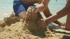 Making castles on the beach.  Stock Footage
