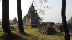 Ancient hindu temple through trees,Gedung Songo,Java,Indonesia Stock Footage