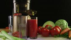 New masticating juicer machine making fresh vegetable tomato juice Stock Footage