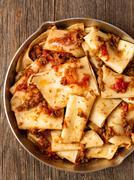 rustic italian pasta in ragu sauce - stock photo
