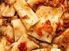 rustic italian pasta in ragu sauce food background - stock photo