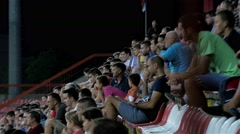 View at stadium stands, people watching soccer match, football fans. - stock footage