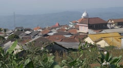 Red roofed village with mosque in mountains,Gedung Songo,Java,Indonesia Stock Footage