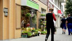 Stock Video Footage of florist's with outside offer on the street - old woman chooses flowers